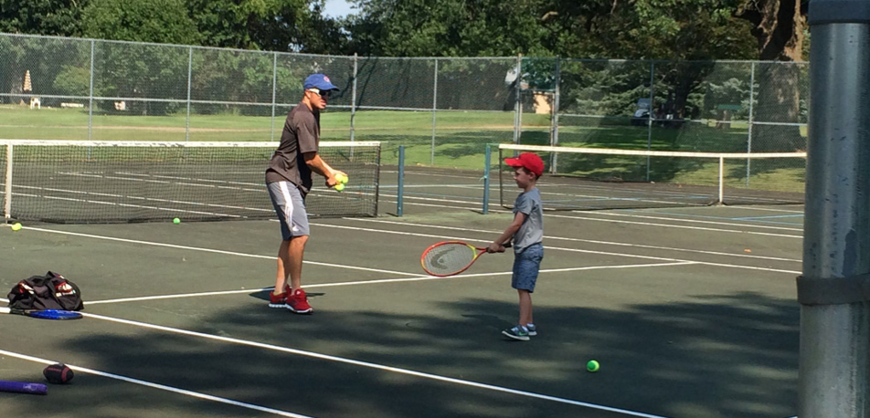 Father and Son at a Kishwaukee CC Tennis court